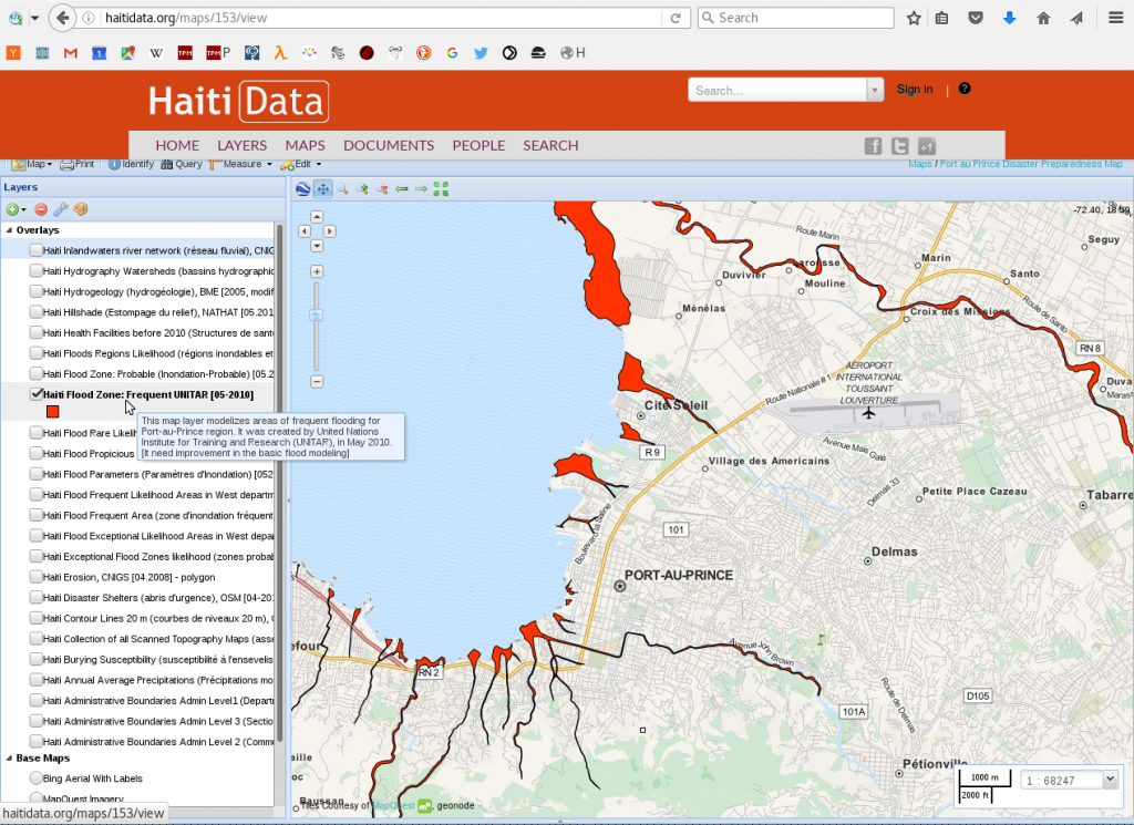 "A map of flood zones in Haiti, rendered with GeoNode. Vulnerable areas are highlighted in red, over a base map showing a street map of Port-au-Prince. The mouse is hovering over a menu item which explains that ""This map layer modelizes areas of frequent flooding for Port-au-Prince region."""